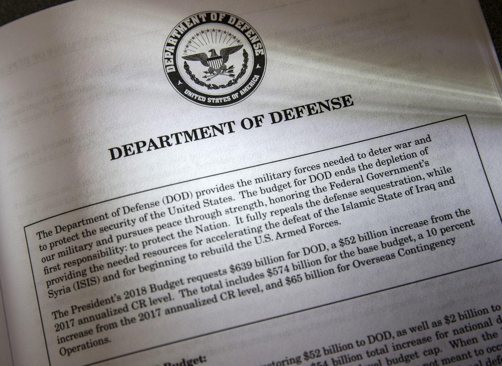 Proposals for the Defense Department in President Donald Trump's first budget are displayed at the Government Printing Office in Washin...