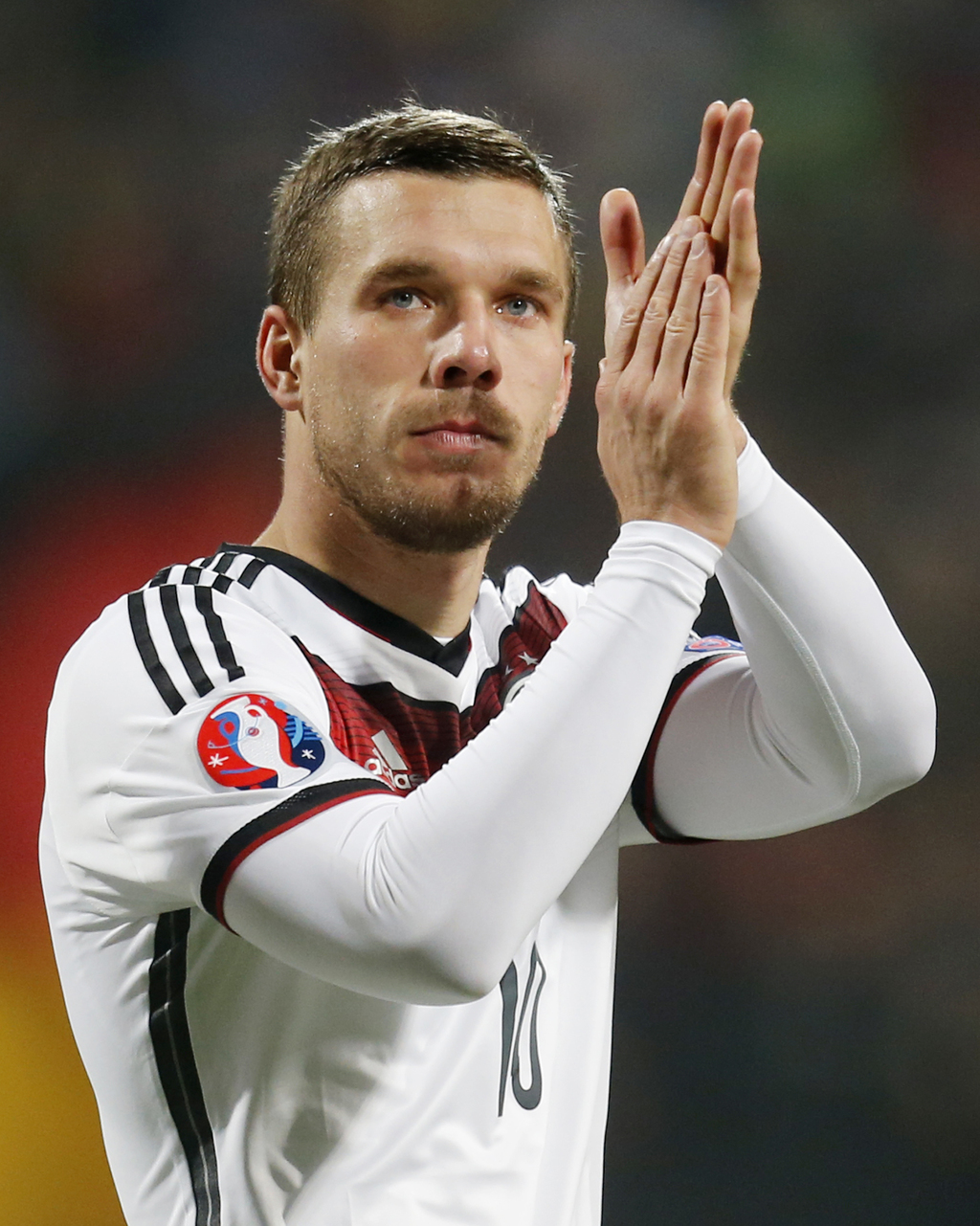 FILE - In this Nov. 14, 2014 file picture Germany's Lukas Podolski applauds after a Group D Euro 2016 qualifying match between Germany ...