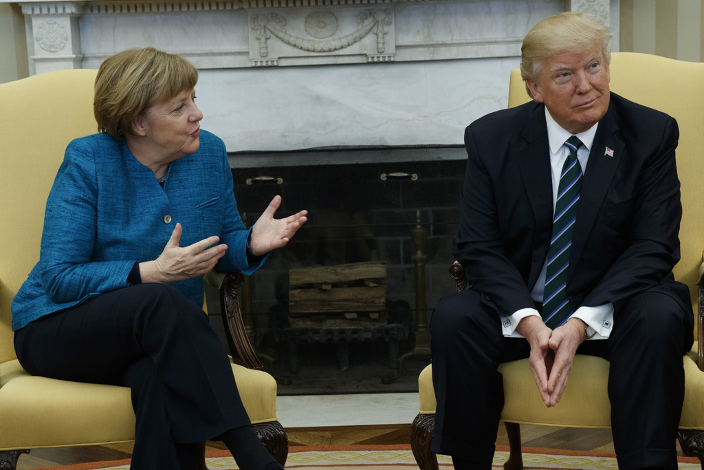 President Donald Trump meets with German Chancellor Angela Merkel in the Oval Office of the White House in Washington, Friday, March 17...