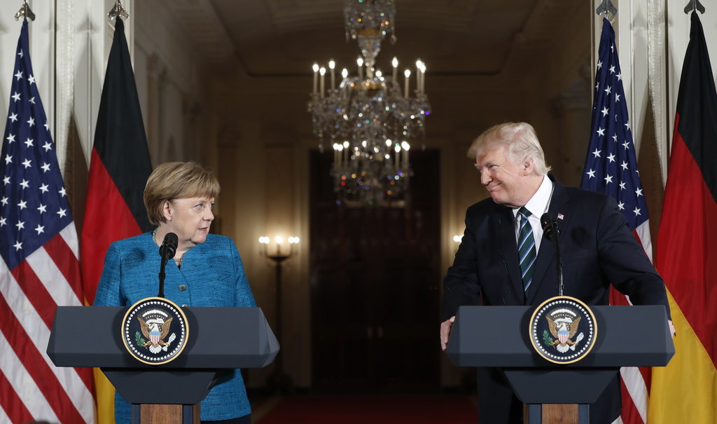 President Donald Trump and German Chancellor Angela Merkel participate in a joint news conference in the East Room of the White House i...