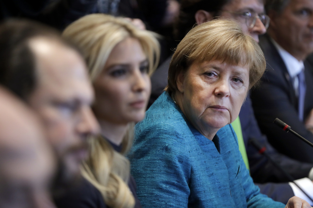 German Chancellor Angela Merkel sits next to Ivanka Trump during a meeting with President Donald Trump at the White House in Washington...
