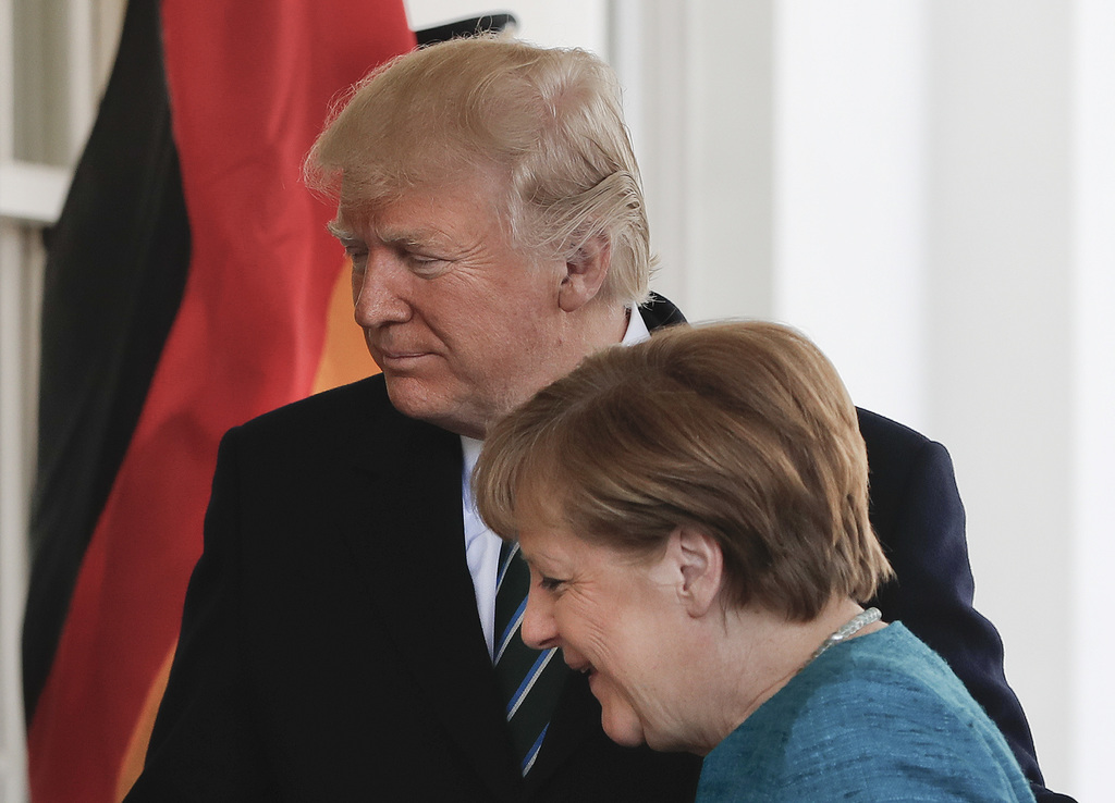 President Donald Trump welcomes German Chancellor Angela Merkel outside the West Wing of the White House in Washington, Friday, March 1...