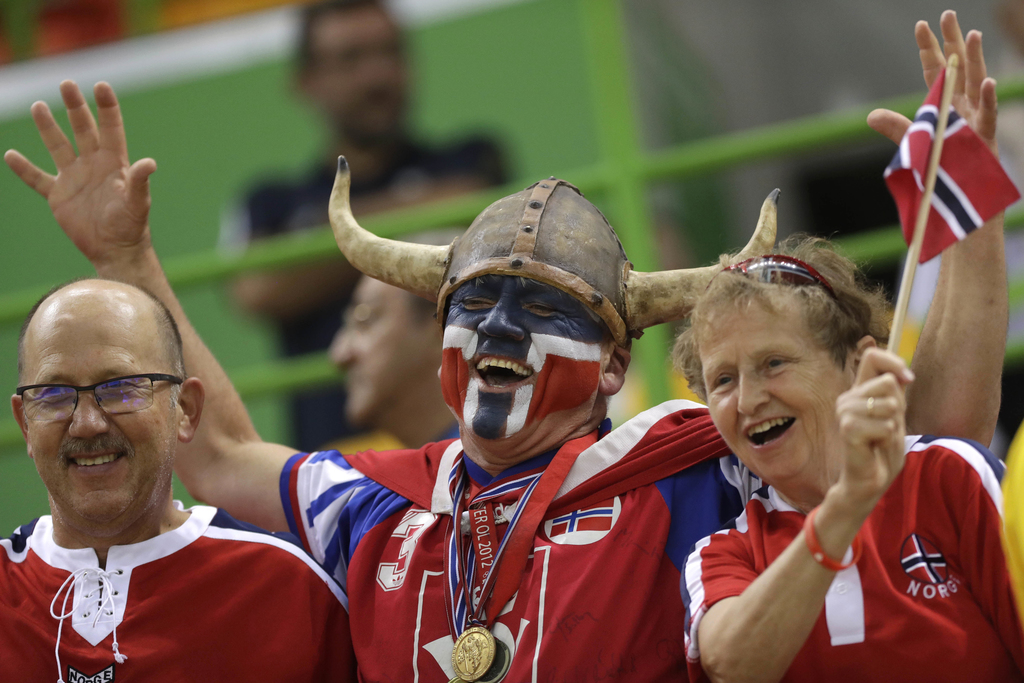 FILE - In this Thursday, Aug. 18, 2016 file photo Norwegian fans wait for the beginning of the women's semifinal handball match between...