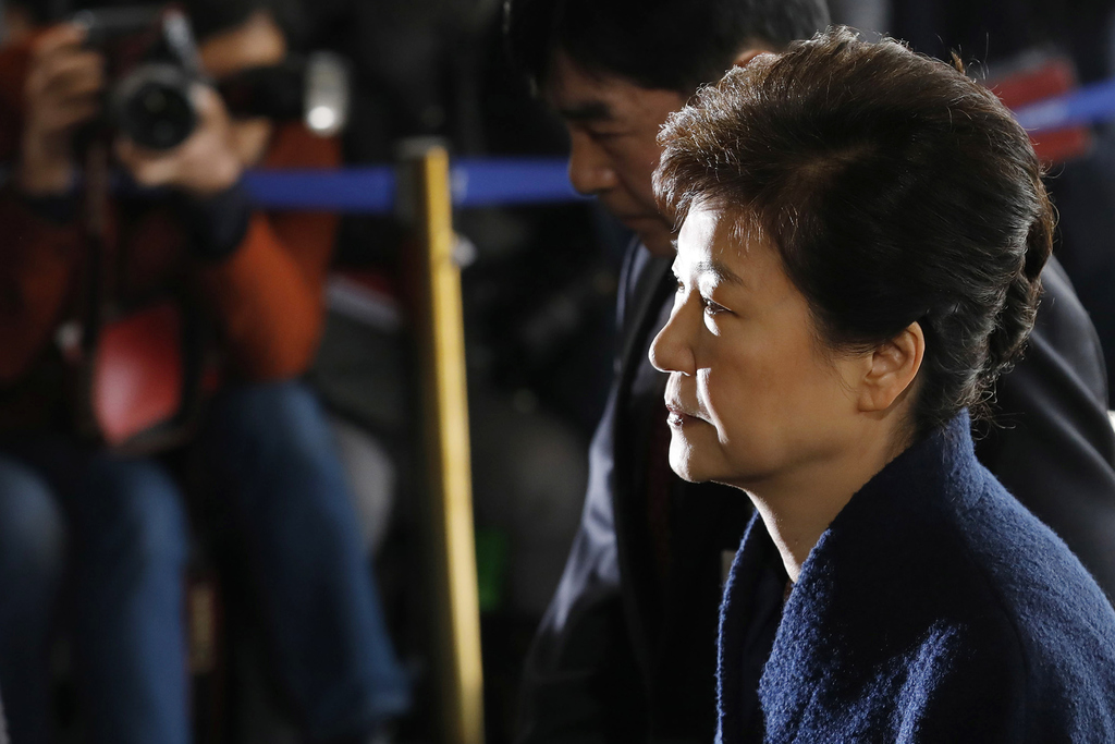 South Korea's ousted leader Park Geun-hye arrives at the prosecutor's office in Seoul, South Korea, Tuesday, March 21, 2017. Park said ...