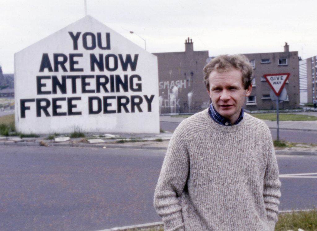 FILE - In this July 1984 file photo Martin McGuinness, Sinn Fein politician and a former Brigade Commander of the IRA poses for a photo...