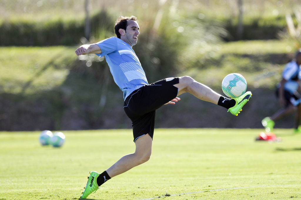 Uruguay's Diego Godin controls the ball during a training session of the national soccer team in the outskirts of Montevideo, Uruguay, ...