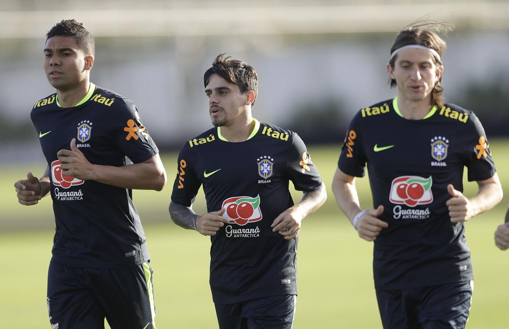 Brazil's Casemiro, left, Fagner, center, and Felipe Luis jog during training session of the national soccer team in Sao Paulo, Brazil, ...