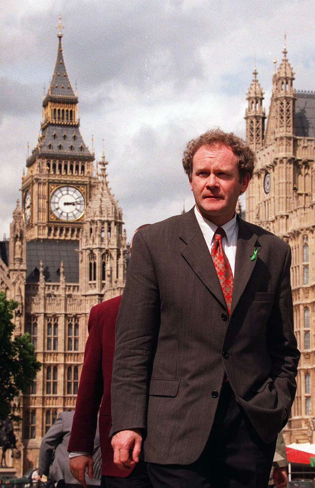 FILE - In this May 13, 1997 file photo Sinn Fein's Martin McGuinness walks past the Houses of Parliament in London. McGuinness, the Iri...