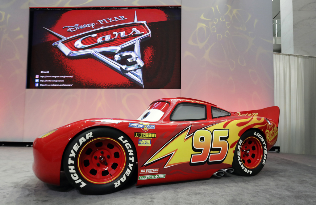 """FILE - In this Jan. 8, 2017 file photo, a vehicle based on the Lightning McQueen animated character from the Disney Pixar """"Cars"""" franch..."""