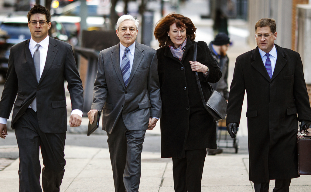 Former Penn State president Graham Spanier, second left,  and his wife Sandra, arrives for the third day of his trial at the Dauphin Co...