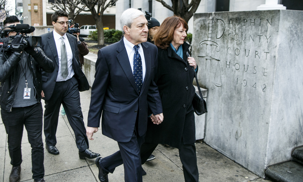 Former Penn State president Graham Spanier arrives for the second day of his trial at the Dauphin County Courthouse, Tuesday, March 21,...