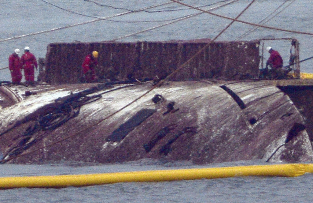 A part of the sunken Sewol ferry is seen in waters off Jindo, South Korea, Thursday, March 23, 2017. Nearly three years after it capsiz...