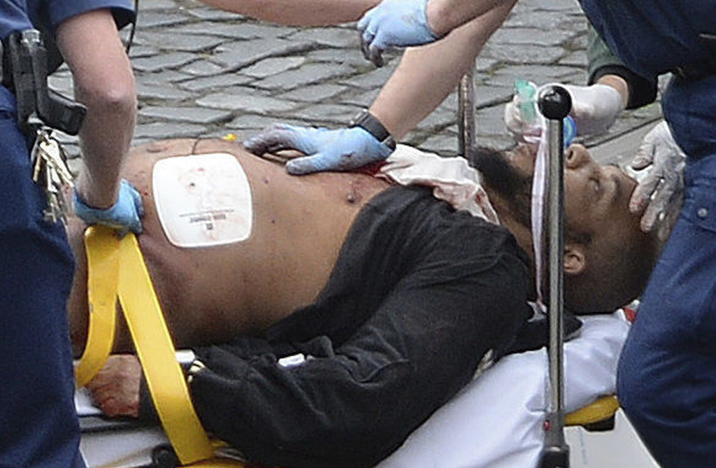 FILE- In this March 22, 2017 file photo, the attacker Khalid Masood is treated by emergency services outside the Houses of Parliament L...