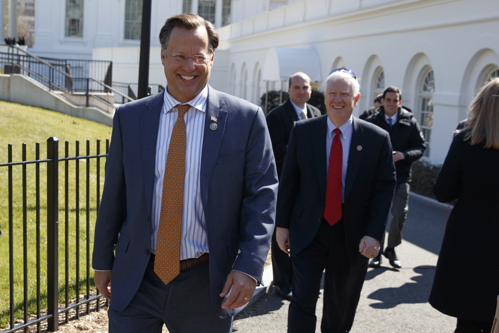 House Freedom Caucus member Rep. Dave Brat, R-Va., and other members, arrives at the White House in Washington, Thursday, March 23, 201...