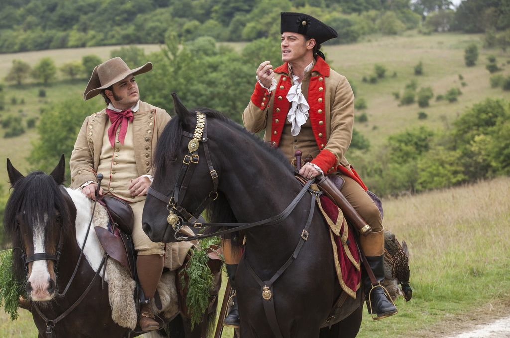 """This image released by Disney, Josh Gad, left, and Luke Evans appear in a scene from, """"Beauty and the Beast."""" (Laurie Sparham/Disney vi..."""
