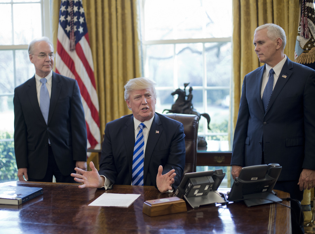 President Donald Trump, flanked by Health and Human Services Secretary Tom Price, left, and Vice President Mike Pence, right, speaks ab...