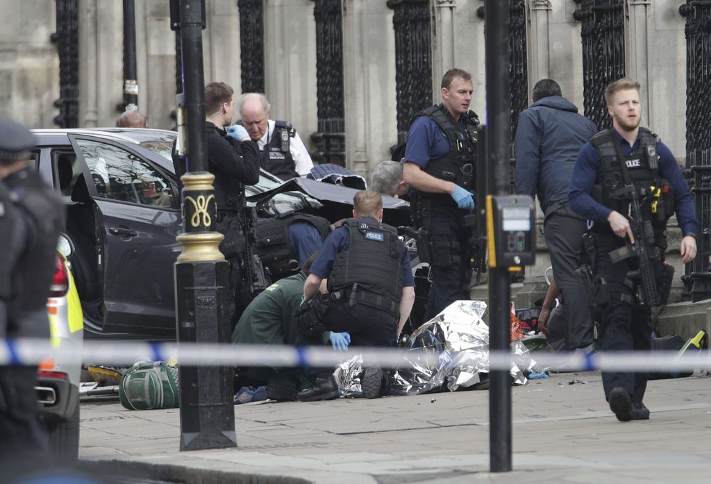 FILE - In this March 22, 2017 file photo, emergency personnel tend to an injured person outside Britain's Parliament after an attack by...