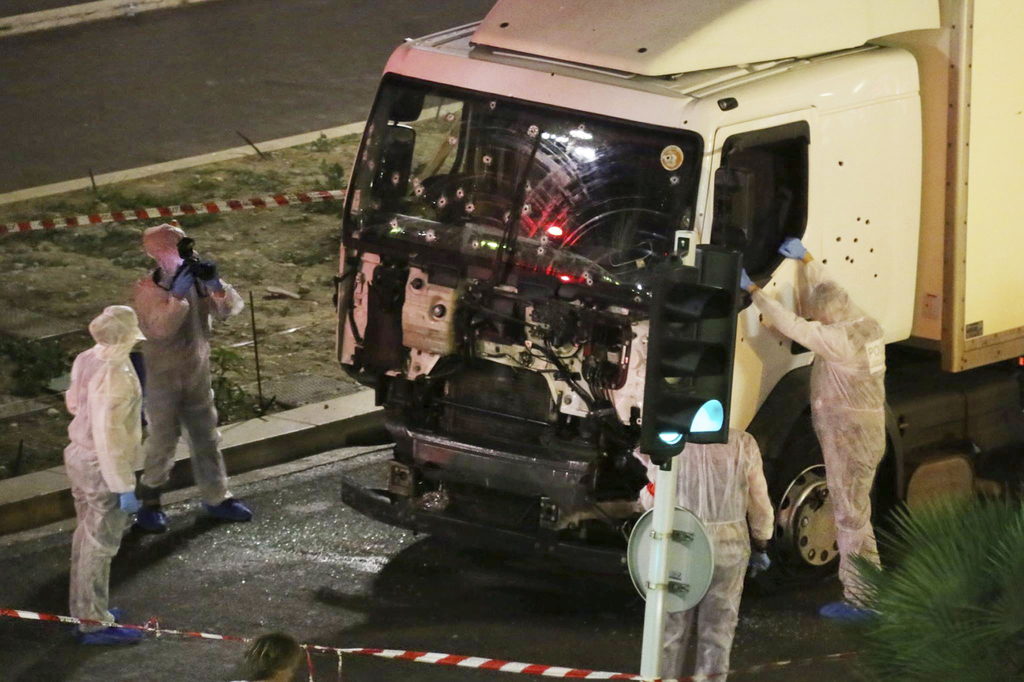 FILE - In this July 14, 2016 file photo, authorities investigate a truck after it plowed through Bastille Day revelers in the French re...