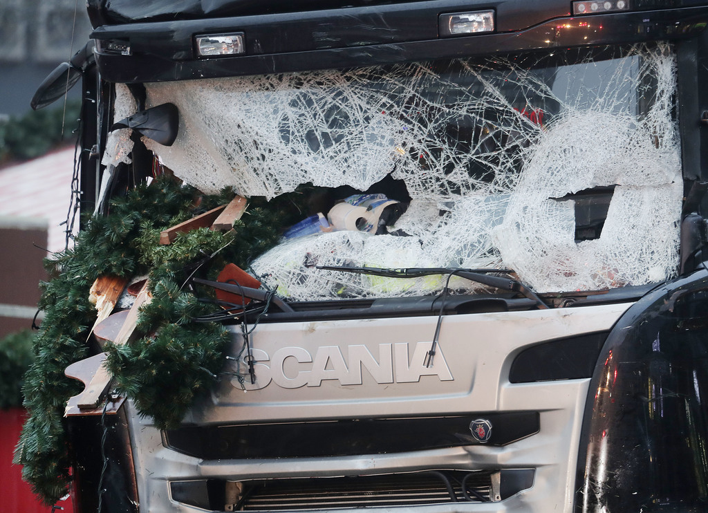 FILE - In this Dec. 20, 2016 file photo, Christmas decoration are stuck in the smashed window of the cabin of a truck which ran into a ...