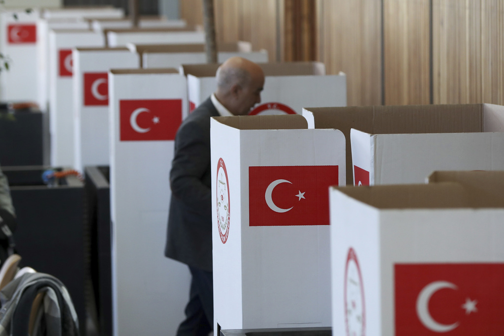 A man casts his ballot for the referendum on the Turkish constitutional reform in Fuerth, southern Germany, Monday,  March 27, 2017. (D...