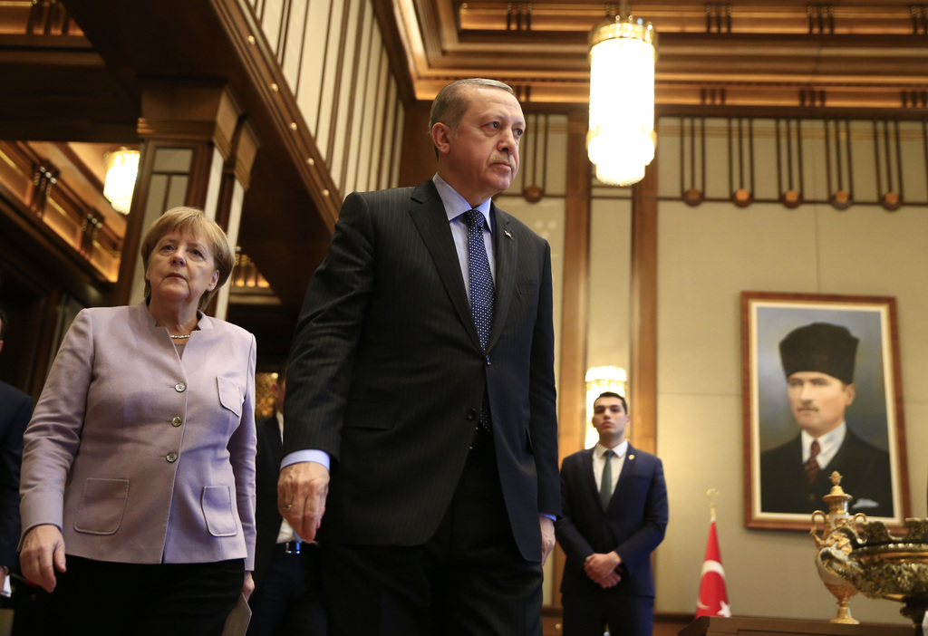 FILE - In this Feb. 2, 2017 file photo German Chancellor Angela Merkel, left, and Turkish President Recep Tayyip Erdogan, center, arriv...