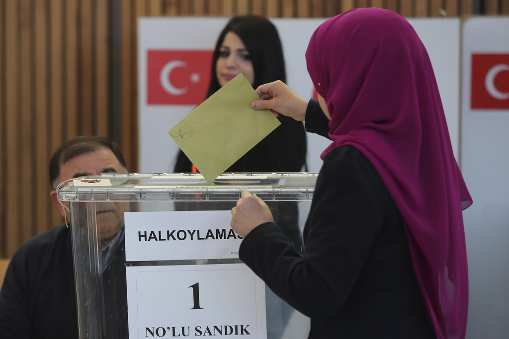 A woman casts her ballot in the referendum on a presidential system in Turkey in Fuerth, southern Germany, Monday, March 27, 2017. (Dan...