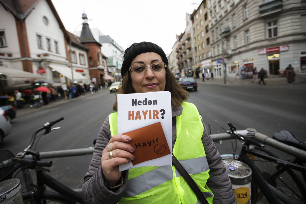 In this Tuesday, March 21, 2017 photo Ayfer Inci-Pekoz poses for a photo as she hands out flyers, reading 'Why No' against the upcoming...