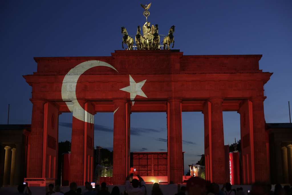 FILE - In this Wednesday, June 29, 2016 file photo, the Brandenburg Gate is illuminated as a Turkish national flag In reaction of a sui...