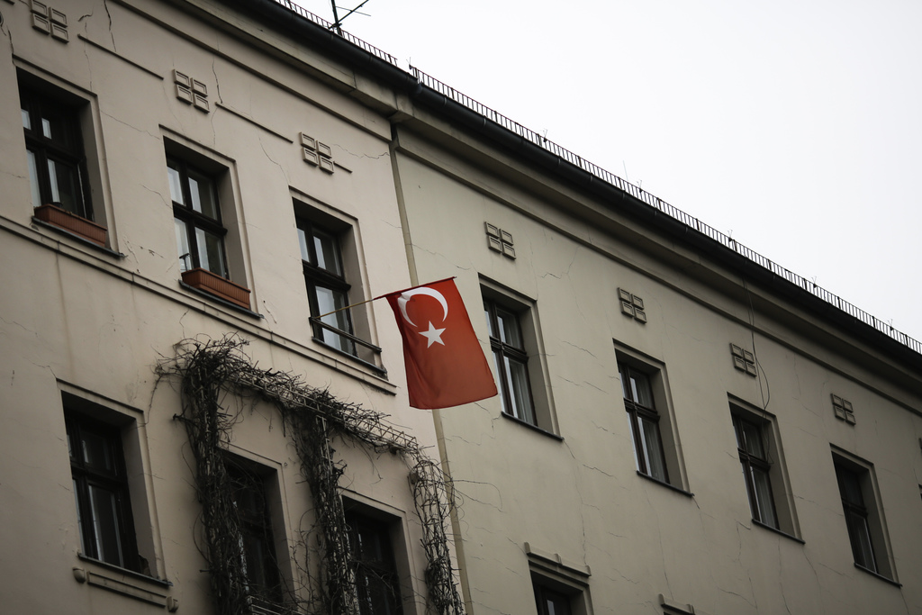 In this Tuesday, March 14, 2017 photo a Turkish national flag is displayed at an apartment building in the district of Kreuzberg in Ber...