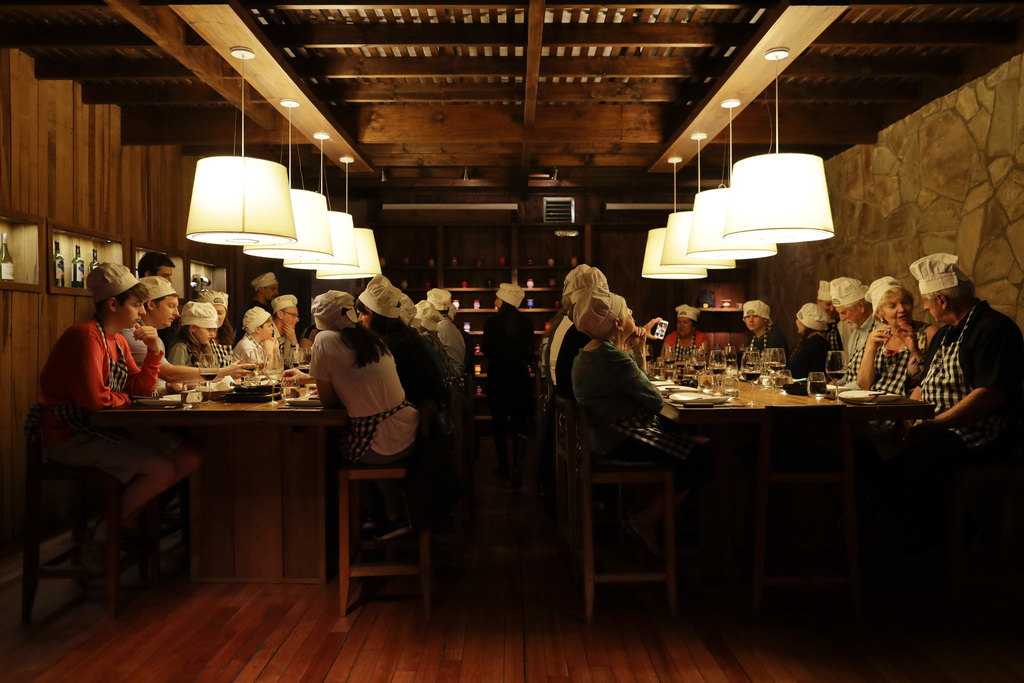 "In this March 20, 2017 photo people have dinner at a restaurant during an activity called ""The Argentine Experience"" in Buenos Aires, A..."