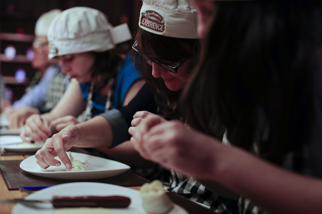 "In this March 20, 2017 photo tourist make their own ""empanada"" during an activity called ""The Argentine Experience"" in Buenos Aires, Ar..."