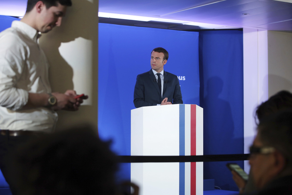 Candidate for the 2017 presidential election Emmanuel Macron, center, gives a press conference, in Paris, Tuesday, March 28, 2017. Macr...