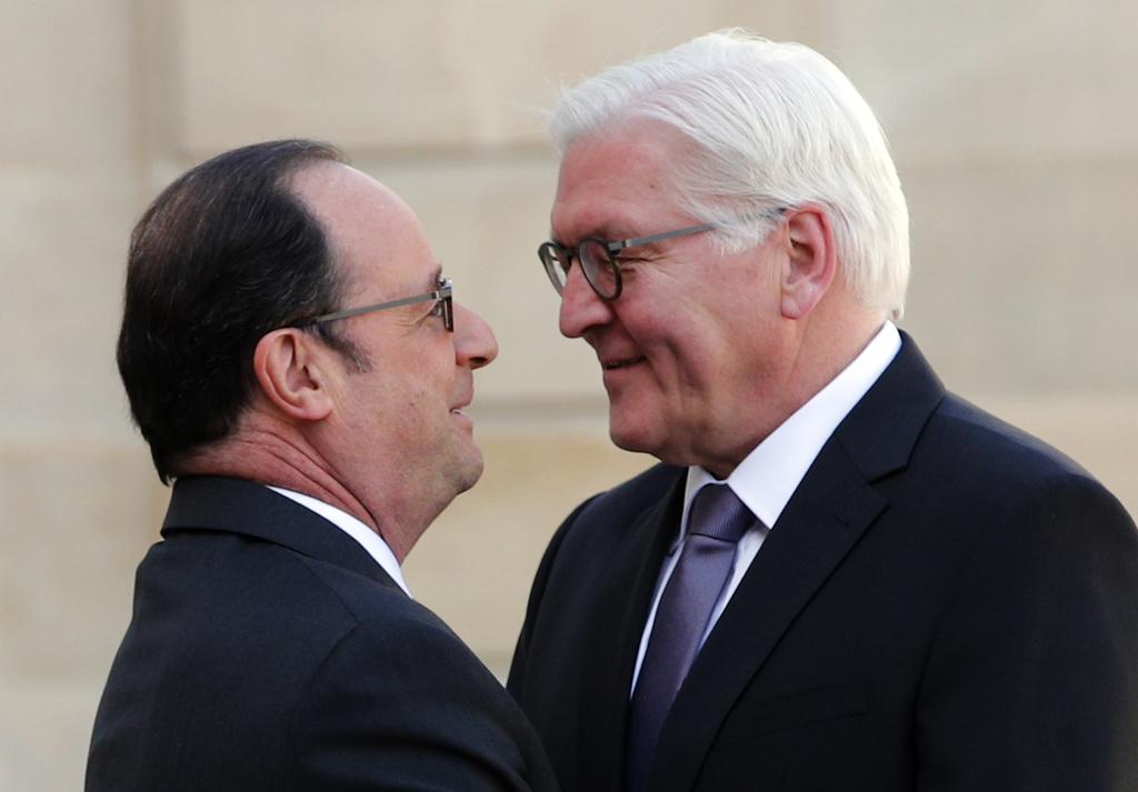 French president Francois Hollande, left, greets German president Frank-Walter Steinmeier before a meeting at the Elysee Palace in Pari...