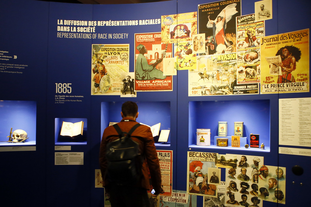 A visitors looks on during a press visit of a prescient exhibit exploring the psychology behind racism at Paris' Museum of Mankind, Thu...