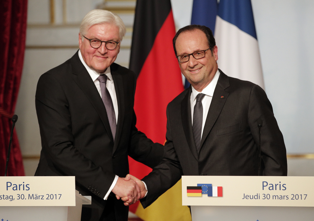 French president Francois Hollande, right, and German president Frank-Walter Steinmeier shake hands after a press conference at the Ely...