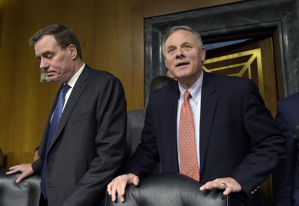 Senate Intelligence Committee Chairman, Sen. Richard Burr, R-N.C., and Vice Chairman Sen. Mark Warner, D-Va., left, arrive for the Sena...