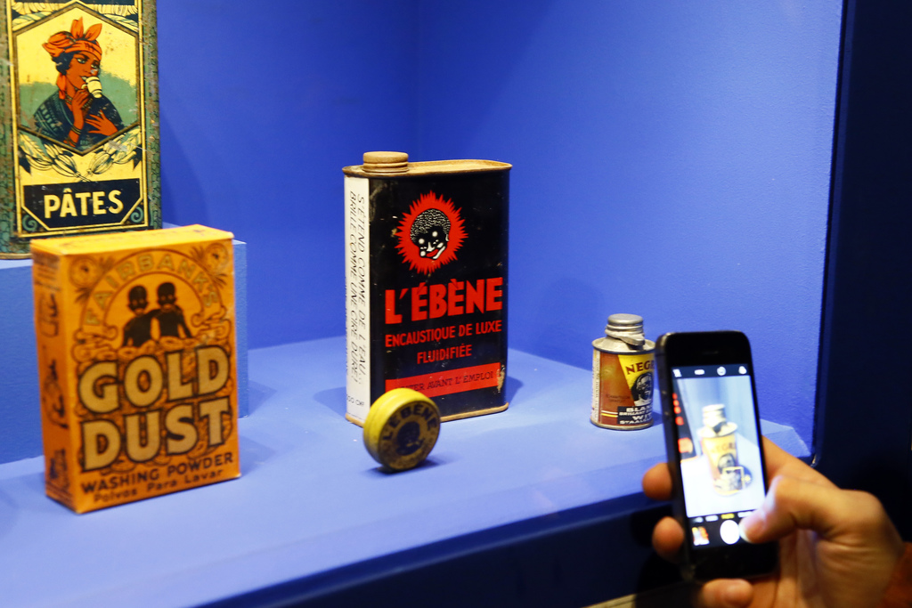 A visitors takes a photo with his phone during a press visit of a prescient exhibit exploring the psychology behind racism at Paris' Mu...