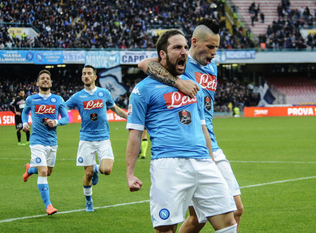FILE- In this Sunday, Feb. 7, 2016 file photo, Napoli's Gonzalo Higuain, front left, celebrates with teammate Marek Hamsik after scorin...