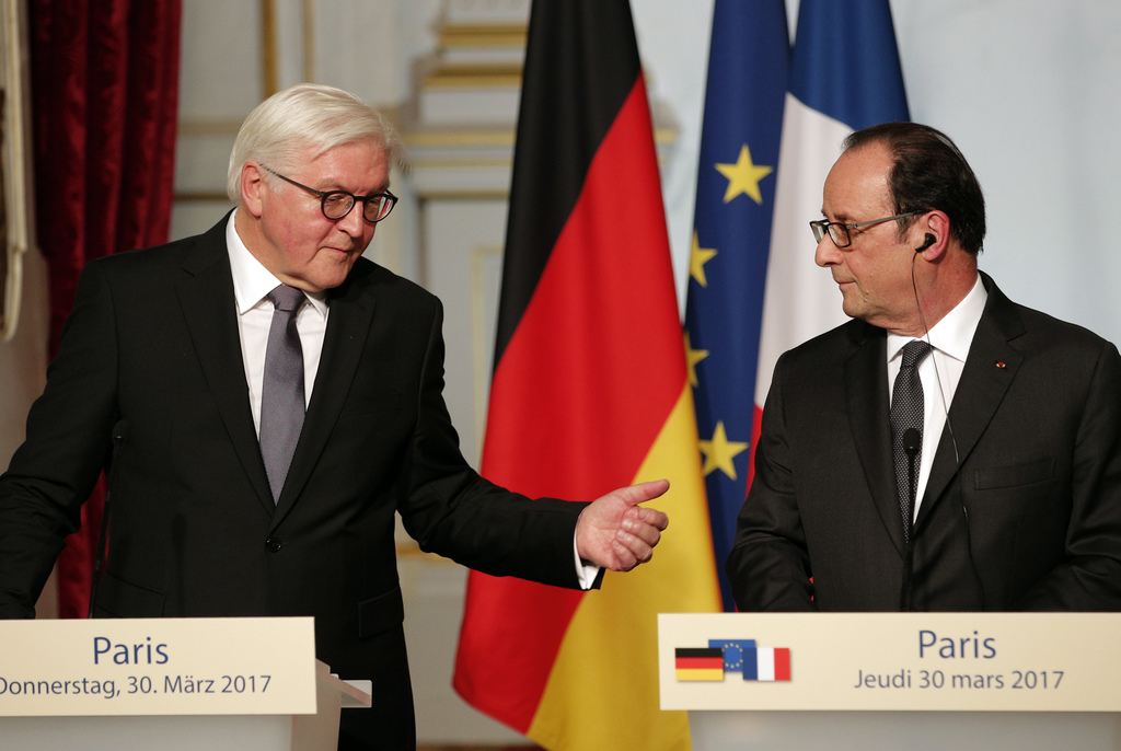 French president Francois Hollande, right, and German president Frank-Walter Steinmeier attend a press conference at the Elysee Palace ...
