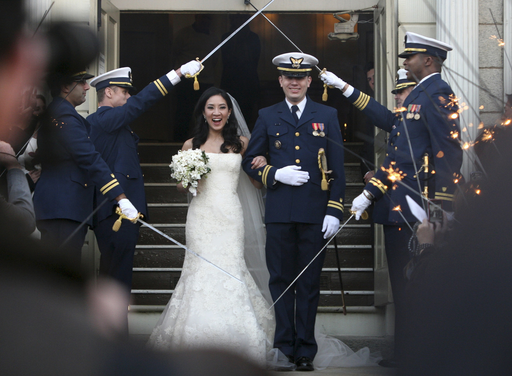 FILE - In this photo Jan. 19, 2013 file photo, Olympic skater, Michelle Kwan and Coast Guard Lt. Clay Pell leave the First Unitarian Ch...
