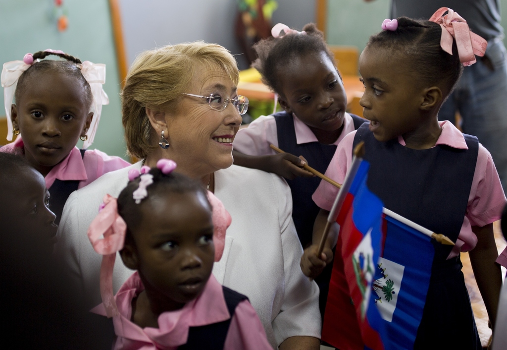 In this March 27, 2017 photo, Chile's President Michelle Bachelet talks to students at the Republique Du Chili school in Port-au-Prince...