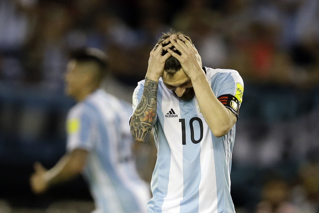 In this March 23, 2017 photo, Argentina's Lionel Messi reacts after missing a chance to score during a World Cup qualifying match again...