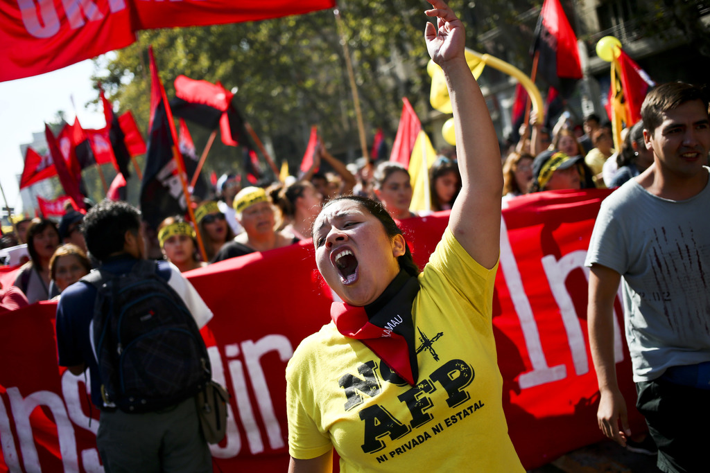 In this March 26, 2017 photo, a woman shout slogans against to Pension Fund Administrators during a march against Pension Fund Administ...