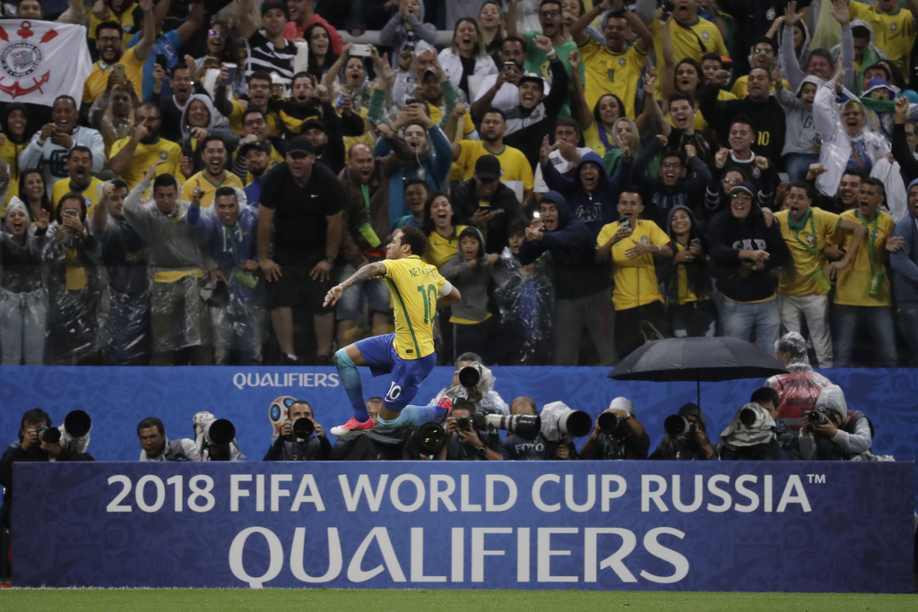 In this March 28, 2017 photo, Brazil's Neymar celebrates scoring his side's 2nd goal during their 2018 World Cup qualifying soccer matc...