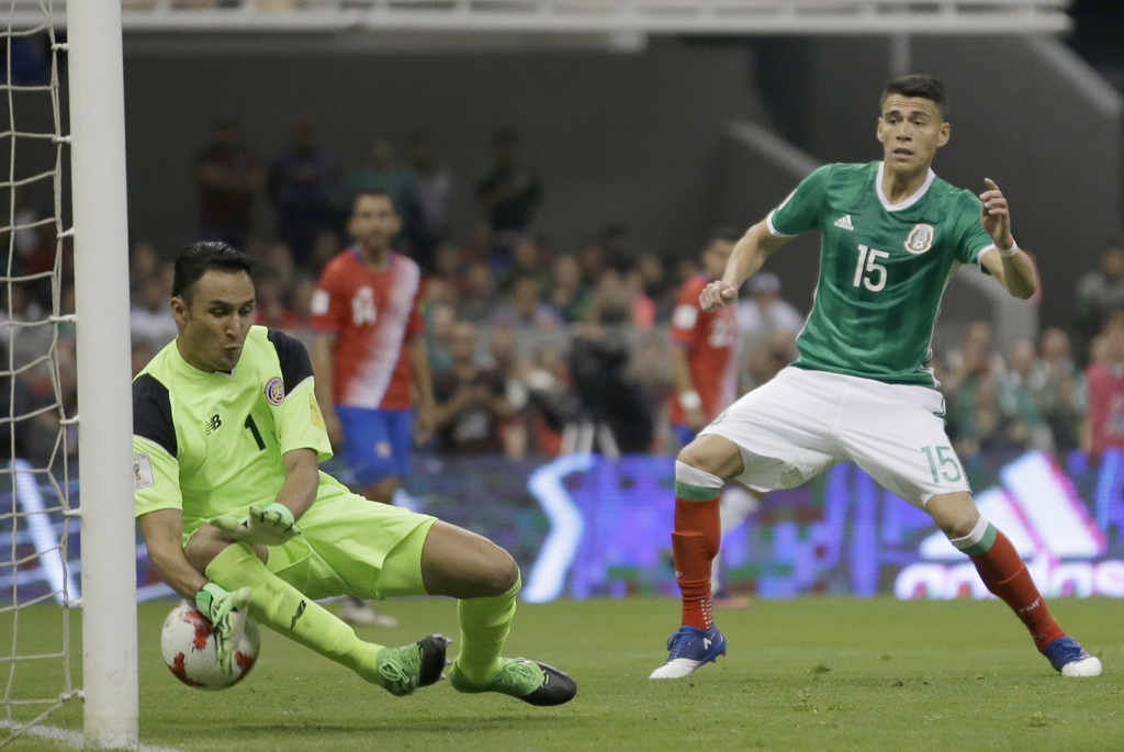 In this March 24, 2017 photo, Costa Rica goalkeeper Keylor Navas, left, fails to stop Mexico's Nestor Araujo scoring his team's second ...