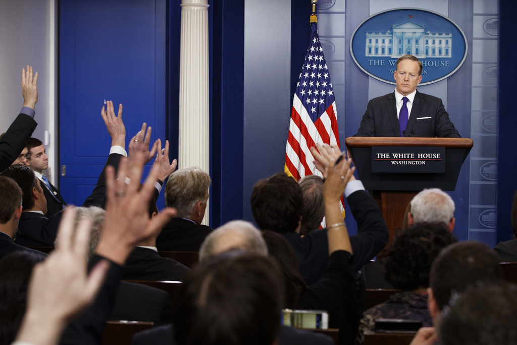 White House press secretary Sean Spicer listens to a question during the daily press briefing, Thursday, March 30, 2017, at the White H...