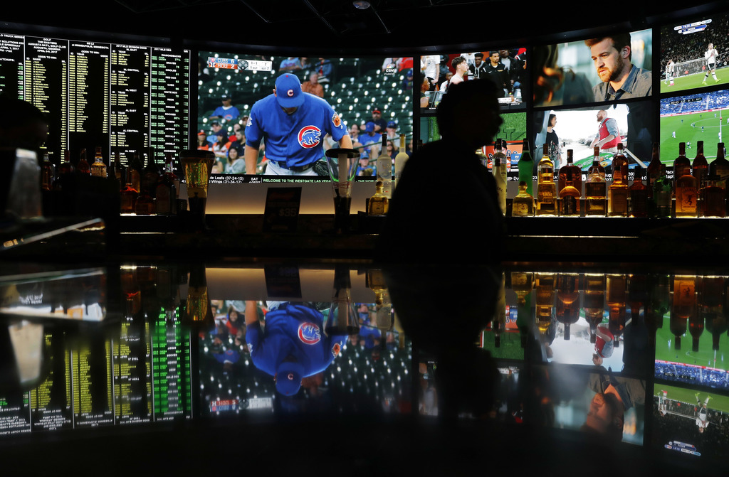 A screen showing a Chicago Cubs spring training baseball game is reflected with other screens on a countertop at the Westgate Superbook...