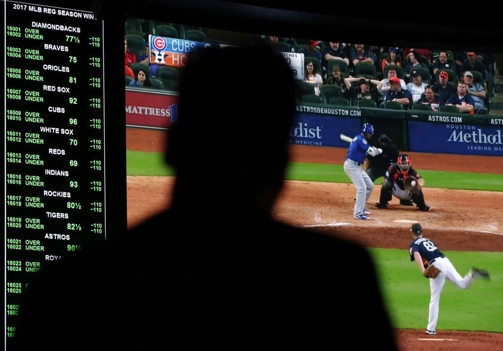 A screen shows a Chicago Cubs spring training baseball game at the Westgate Superbook sports book, Friday, March 31, 2017, in Las Vegas...