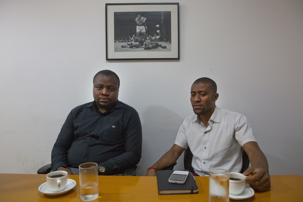In this Thursday, March 30, 2017 photo, Samuel Jack, left, president of the African Students' Association, and Ezeugo Nnamdi Lawrence, ...