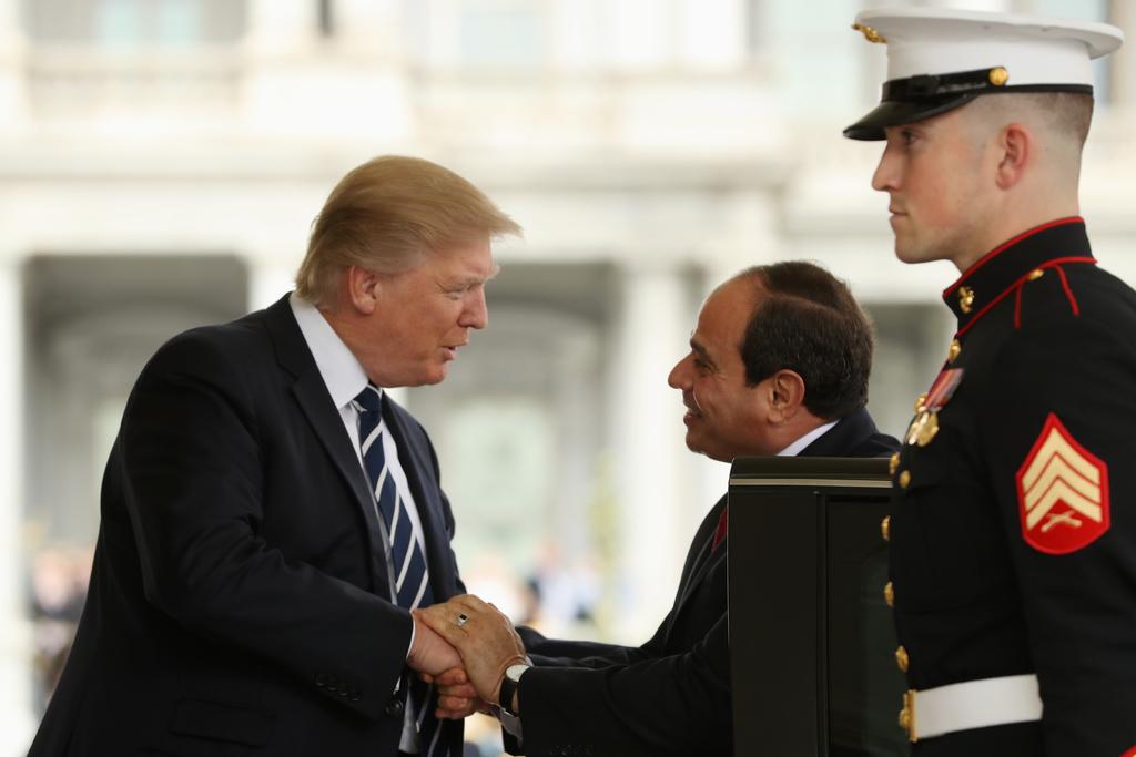 President Donald Trump greets Egyptian President Abdel Fattah Al-Sisi as he arrives at the White House in Washington, Monday, April 3, ...